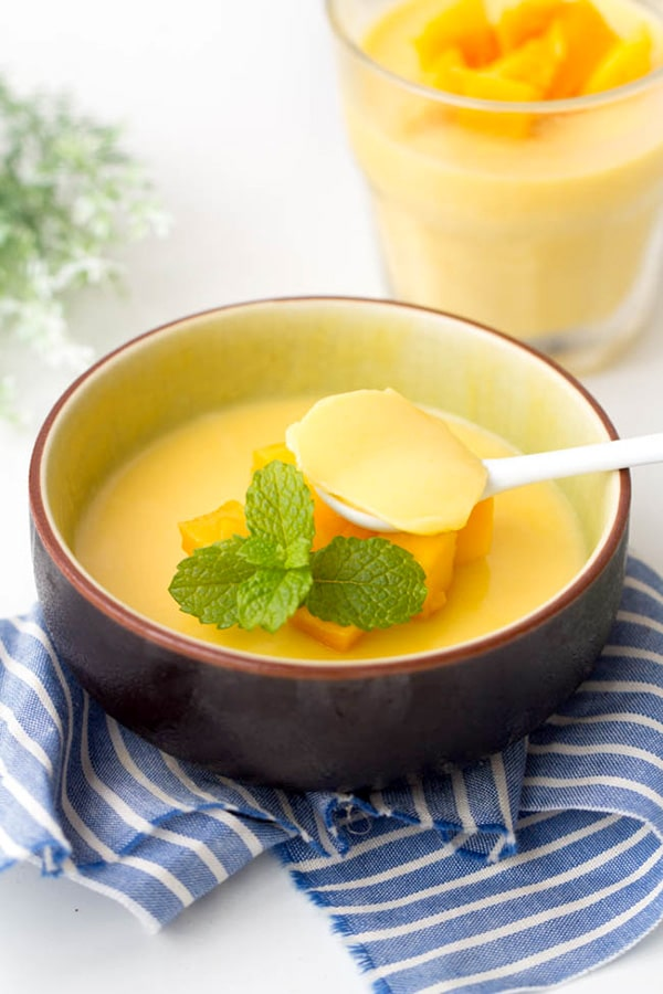 mango pudding with mint garnish on top