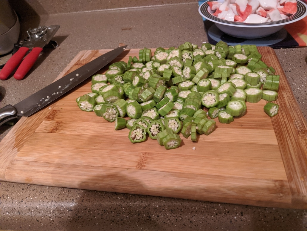 Chopped okra and crab in the back for our jambalaya.