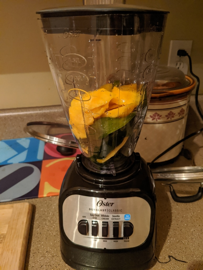 Blending our peppers and mangoes to create the aji amarillo paste for the lomo saltado.